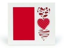 与红色心脏的白色照片框架在isolaed背景 免版税库存照片