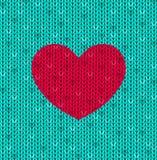 与红色心脏的被编织的卡片 免版税库存图片