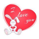 与红色心脏的逗人喜爱的小的兔宝宝 库存图片