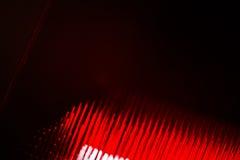 与红色条纹的被弄脏的背景 库存图片