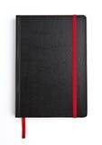 与红色条纹的黑皮革笔记本日志 免版税库存照片