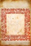 与红色框架的老纸 免版税库存照片