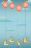与红色气球的词爱 免版税库存照片
