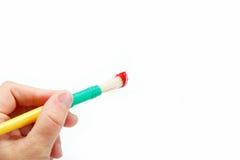 与红色油漆的女性现有量藏品画笔。 免版税库存图片