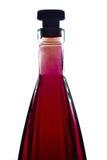 与红色液体的瓶 库存图片