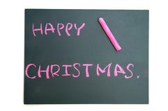 与红色白垩的愉快的圣诞节在黑板 库存图片