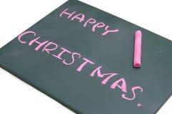 与红色白垩的愉快的圣诞节在黑板 免版税图库摄影