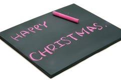 与红色白垩的愉快的圣诞节在黑板 免版税库存照片