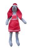 与红色耳朵的被隔绝的手工制造玩偶野兔在红色围裙 免版税库存图片