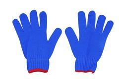 与红色边缘的蓝色被编织的手套 免版税库存照片