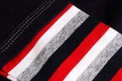 与红色,黑,灰色,米黄和白色颜色的镶边布料 免版税库存照片