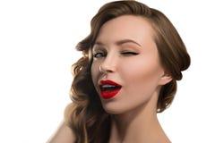 与红色嘴唇的美好的年轻模型 免版税库存照片
