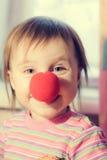 与红色鼻子的孩子 免版税库存图片
