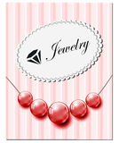 与红色玻璃珍珠的首饰卡片 免版税库存图片