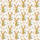 与红萝卜无缝的样式的逗人喜爱的复活节兔子 免版税库存照片