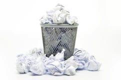 与纸张浪费的垃圾桶 图库摄影