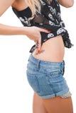 与纹身花刺的妇女臀部 库存照片