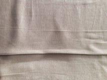 与线缝的帆布肤色的布料 库存图片