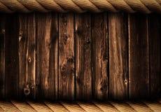 与绳索框架的Grunge木背景或背景 免版税图库摄影