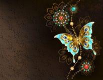 与绿松石蝴蝶的布朗背景 皇族释放例证
