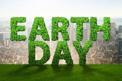 与绿色信件的地球日概念 免版税库存照片