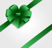 与绿色弓的节假日背景 免版税库存照片