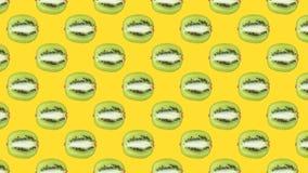 与绿色猕猴桃的一个无缝的样式 免版税库存图片