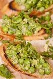 与绿色蔬菜的鲜美bruschetta 图库摄影