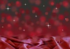 与缎的抽象红色和黑bokeh圣诞节背景 免版税库存图片