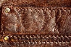 与缝的真正棕色皮革 免版税库存图片