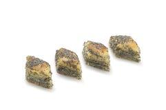 与罂粟的种子的几个蛋糕在白色背景隔绝的果仁蜜酥饼和蜂蜜 免版税图库摄影