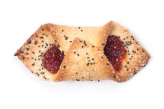 与罂粟种子和果酱的一个曲奇饼 库存照片