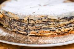 与罂粟种子的自创蛋糕 库存照片