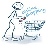 与网上购物车的棍子形象 图库摄影