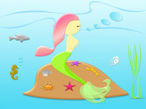 与美丽的美人鱼的自然概念在海下 库存图片