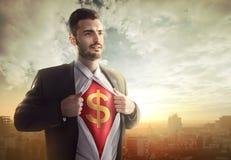 与美元的符号的商人作为超级英雄 免版税图库摄影