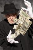 与美元钞票的魔术师展示 库存照片