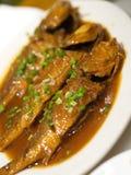 与美味的口味的三条鱼 吃和采取在北京 凯爱 免版税库存照片