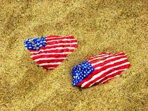 与美国国旗的石头 库存图片