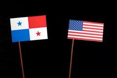 与美国旗子的巴拿马旗子在黑色 免版税库存照片
