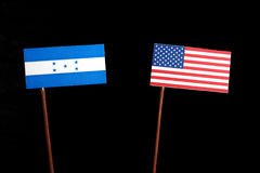 与美国旗子的洪都拉斯旗子在黑色 免版税图库摄影