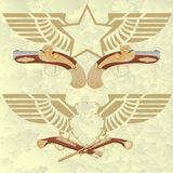 与翼和古老武器的徽章 免版税库存照片