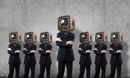 与老电视的商人而不是头 图库摄影