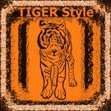 与老虎的商标 老虎与手拉的老虎f的标签设计 图库摄影