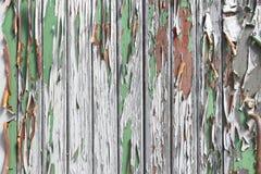 与老weatherd油漆的木头作为背景 免版税库存图片