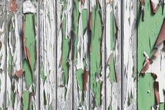 与老weatherd油漆的木头作为背景 免版税库存照片