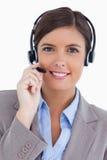 与耳机的女性呼叫中心座席 免版税库存照片
