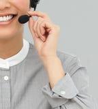 与耳机的客户服务部座席在微笑 免版税图库摄影