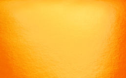 与聚光灯的抽象茶黄背景 库存照片