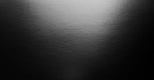 与聚光灯的抽象黑色背景 库存照片